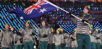 Scott James carries the Australian flag at the Winter Olympic Games opening ceremony